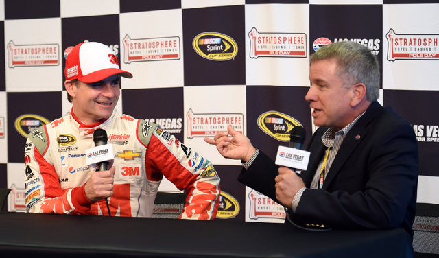Las Vegas Motor Speedway president Chris Powell, right, presents NASCAR Sprint Cup Series driver Jeff Gordon a commemorative poker table to celebrate his retirement tour during Stratosphere Pole D ...