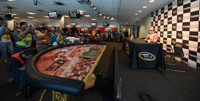 NASCAR Sprint Cup Series driver Jeff Gordon is presented with a commemorative poker table from Las Vegas Motor Speedway to celebrate his retirement tour during Stratosphere Pole Day at Las Vegas M ...