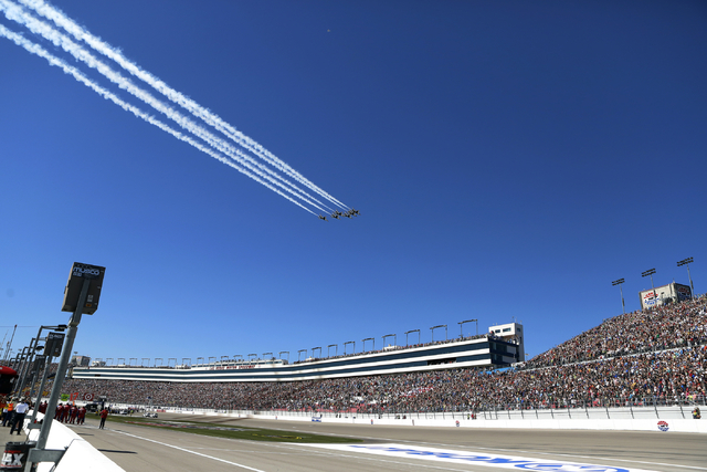 United State Air Force Thurnderbirds make a pass during the National Anthem before the start of the NASCAR Sprint Cup Series Kobalt 400 race at the Las Vegas Motor Speedway on Sunday, March 8, 201 ...