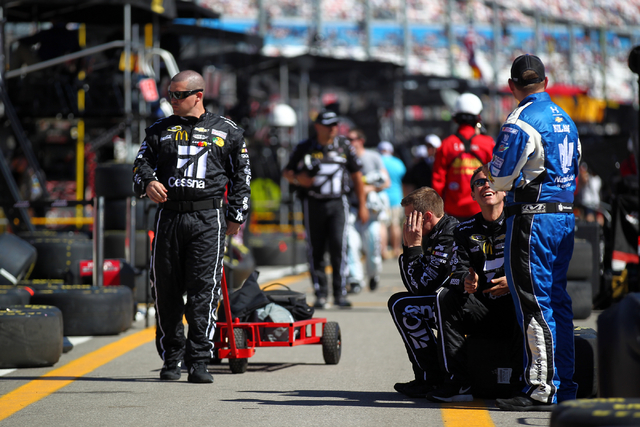 Pit crew members prepare for the start of the NASCAR Sprint Cup Series Kobalt 400 race at the Las Vegas Motor Speedway on Sunday, March 8, 2015. (Chase Stevens/Las Vegas Review-Journal)