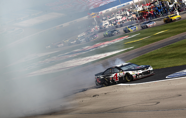 Kevin Harvick (4) performs a burnout after winning the NASCAR Sprint Cup Series Kobalt 400 race at the Las Vegas Motor Speedway on Sunday, March 8, 2015. (Chase Stevens/Las Vegas Review-Journal)