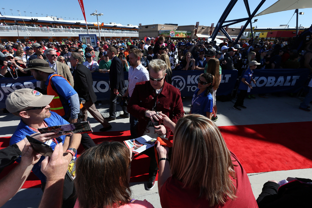 Gary LeVox, lead singer of Rascal Flatts, signs autographes before performing at the NASCAR Sprint Cup Series Kobalt 400 race at the Las Vegas Motor Speedway on Sunday, March 8, 2015. (Chase Steve ...