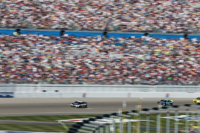 Kevin Harvick (4), left, leads during the NASCAR Sprint Cup Series Kobalt 400 race at the Las Vegas Motor Speedway on Sunday, March 8, 2015. Harvick won the race. (Chase Stevens/Las Vegas Review-J ...