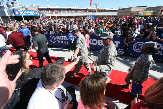 Nellis Air Force Base airmen greet supporters before for the start of the NASCAR Sprint Cup Series Kobalt 400 race at the Las Vegas Motor Speedway on Sunday, March 8, 2015. (Chase Stevens/Las Vega ...