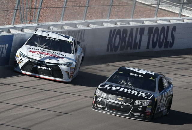 Jeb Burton (26) collides with the wall as Jimmie Johnson (48) passes during the NASCAR Sprint Cup Series Kobalt 400 race at the Las Vegas Motor Speedway on Sunday, March 8, 2015. Kevin Harvick won ...