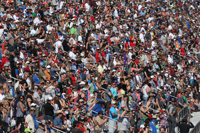 Fans watch the NASCAR Sprint Cup Series Kobalt 400 race at the Las Vegas Motor Speedway on Sunday, March 8, 2015. Kevin Harvick won the race. (Chase Stevens/Las Vegas Review-Journal)