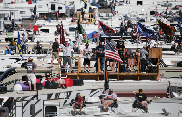 Fans on top of RVs watch the NASCAR Sprint Cup Series Kobalt 400 race at the Las Vegas Motor Speedway on Sunday, March 8, 2015. Kevin Harvick won the race. (Chase Stevens/Las Vegas Review-Journal)
