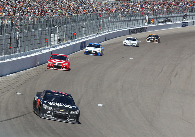 Martin Truex Jr. (78) drives into turn 1 during the NASCAR Sprint Cup Series Kobalt 400 race at the Las Vegas Motor Speedway on Sunday, March 8, 2015. Truex Jr. placed second. (Chase Stevens/Las V ...