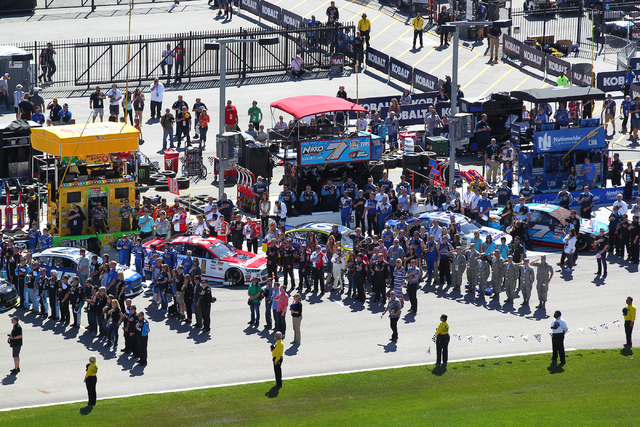 Team members stand during the National Anthem before the start of the NASCAR Sprint Cup Series Kobalt 400 race at the Las Vegas Motor Speedway on Sunday, March 8, 2015. (Chase Stevens/Las Vegas Re ...
