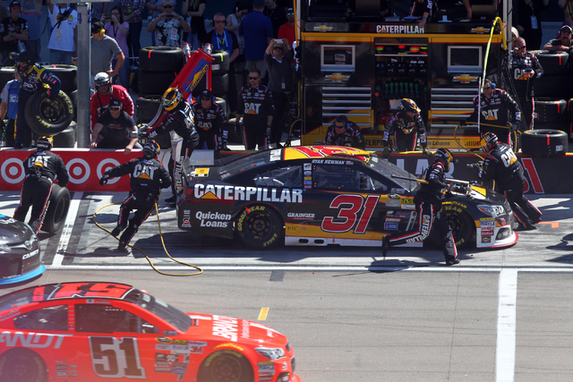 Ryan Newman pit crew works on his car during the NASCAR Sprint Cup Series Kobalt 400 race at the Las Vegas Motor Speedway on Sunday, March 8, 2015. (Chase Stevens/Las Vegas Review-Journal)
