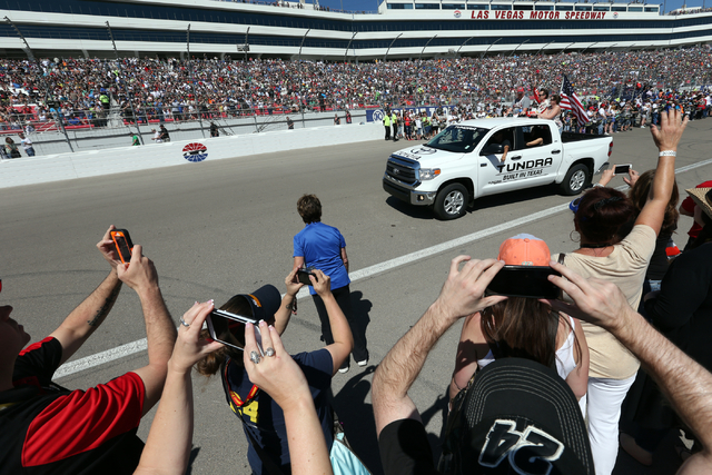Jeff Gordon waves to the crowd during driver introductions before the start of the NASCAR Sprint Cup Series Kobalt 400 race at the Las Vegas Motor Speedway on Sunday, March 8, 2015. (Chase Stevens ...