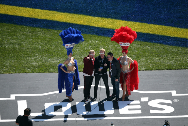 Rascal Flats sings the National Anthem with Las Vegas showgirls before the start of the NASCAR Sprint Cup Series Kobalt 400 race at the Las Vegas Motor Speedway on Sunday, March 8, 2015. (Chase St ...