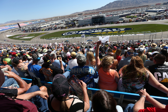 Fans cheer before the start of the NASCAR Sprint Cup Series Kobalt 400 race at the Las Vegas Motor Speedway on Sunday, March 8, 2015. (Chase Stevens/Las Vegas Review-Journal)