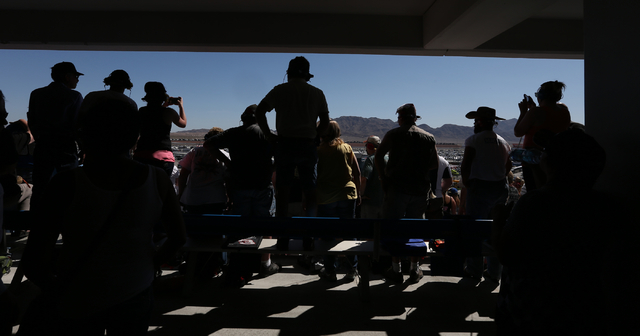 Fans watch the action before the start of the NASCAR Sprint Cup Series Kobalt 400 race at the Las Vegas Motor Speedway on Sunday, March 8, 2015. (Chase Stevens/Las Vegas Review-Journal)