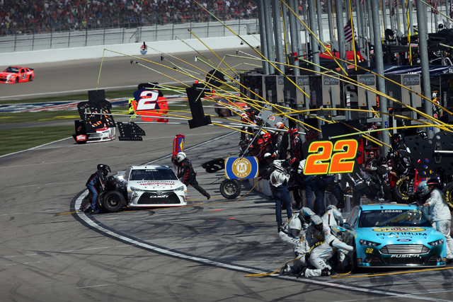 Drivers including Joey Logano (22), right and Jeb Burton (26) pit during the NASCAR Sprint Cup Series Kobalt 400 race at the Las Vegas Motor Speedway on Sunday, March 8, 2015. (Chase Stevens/Las V ...
