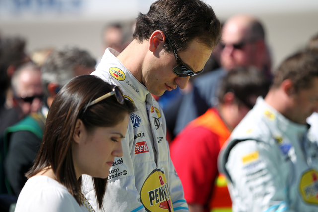 Joey Logano (22) and his wife Brittany Baca bow their heads before the start of the NASCAR Sprint Cup Series Kobalt 400 race at the Las Vegas Motor Speedway on Sunday, March 8, 2015. (Erik Verduzc ...