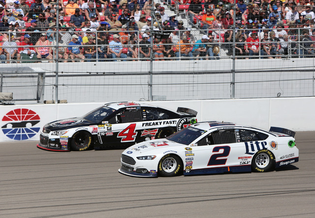 Kevin Harvick (4) left, and Brad Keselowski (2) lead the field during the NASCAR Sprint Cup Series Kobalt 400 race at the Las Vegas Motor Speedway on Sunday, March 8, 2015. (Bizuayehu Tesfaye/Las  ...