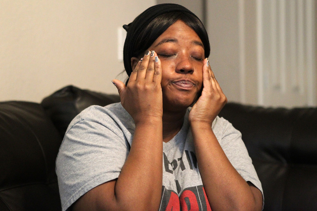 Natika Bird wipes tears off her face as she speaks on the timeline leading up to her daughter Carla Jamerson, 14, committing suicide on the night of Feb. 27, during an interview at her home in Las ...