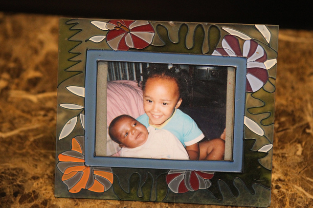 A picture of Jonathan Jamerson, left, at 2 months, with her sister Carla, 3, is seen at the home of their mother Natika Bird in Las Vegas Thursday, March 5, 2015. Bird's son died at two months in  ...