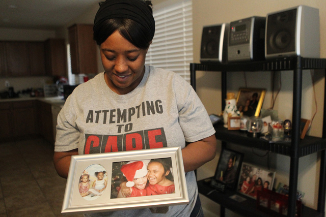 Natika Bird smiles as she shows a picture of her daughter Crista Jamerson, left, with her sister Carla, during an interview at their home in Las Vegas Thursday, March 5, 2015. Bird's son died at t ...