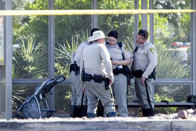 Las Vegas police officer stand near a stroller where a child was hit by a vehicle on Monday, March 30,2015. (Jeff Scheid/Las Vegas Review-Journal) Follow Jeff Scheid on Twitter @jlscheid