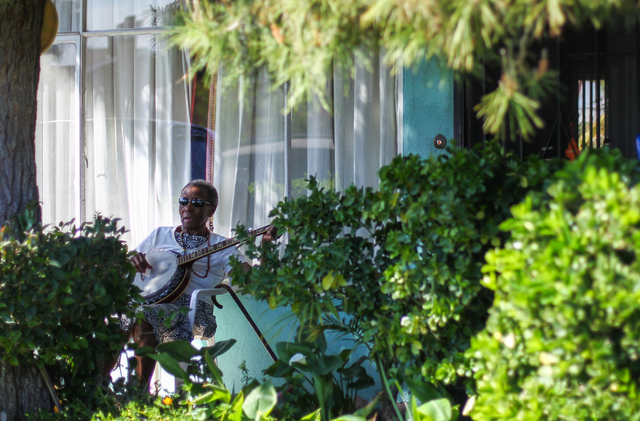 Ninetey-year-old Rozener Whitehead plays her banjo while singing outside of her home off of J Street and Wyatt Avenue on Tuesday, March 24, 2015. Whitehead has lived in Las Vegas since 1951. (Chas ...