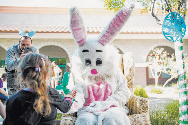 Catholic charities gives kids an early easter photos las vegas the easter bunny greets kids at catholic charities of southern nevada during their celebration of early negle Images