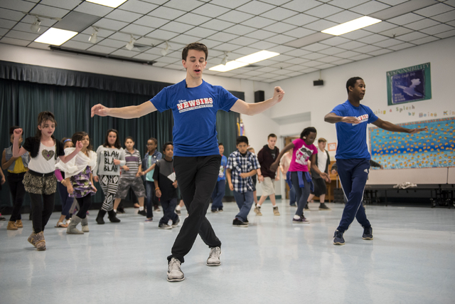 "Newsies cast members, from left in blue shirts, Chaz Wolcott and Jordan Samuels teach kids a dance routine as part of Disney Theatrical Productions' new wellness and fitness program ""Get Up and Go ..."