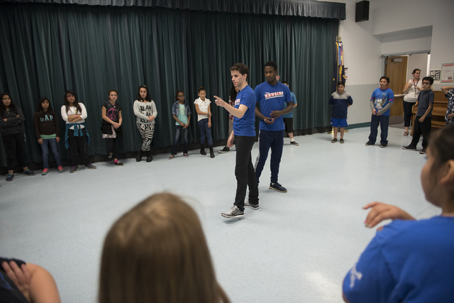 "Newsies cast members, from left in blue shirts, Chaz Wolcott and Jordan Samuels teach kids a dance routine as part of Disney Theatrical Productions' new wellness and fitness program ""Get Up a ..."