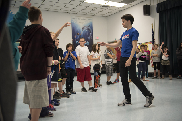 "Newsies cast member Chaz Wolcott, at right in the blue shirt, interacts with kids as part of Disney Theatrical Productions' new wellness and fitness program ""Get Up and Go"" at Doris Fren ..."
