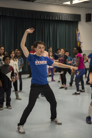 "Newsies cast member Chaz Wolcott teaches kids a dance routine as part of Disney Theatrical Productions' new wellness and fitness program ""Get Up and Go"" at Doris French Elementary School ..."