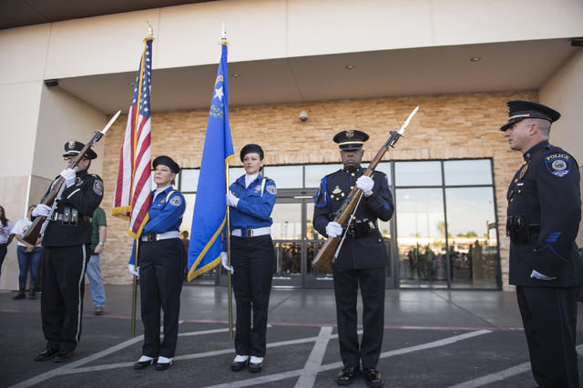 The Las Vegas Metropolitan Police Department honor guard presents colors during the annual Scoot and Shoot Poker Run on Saturday, March 21, 2015, at Red Rock Harley-Davidson in Las Vegas. The even ...