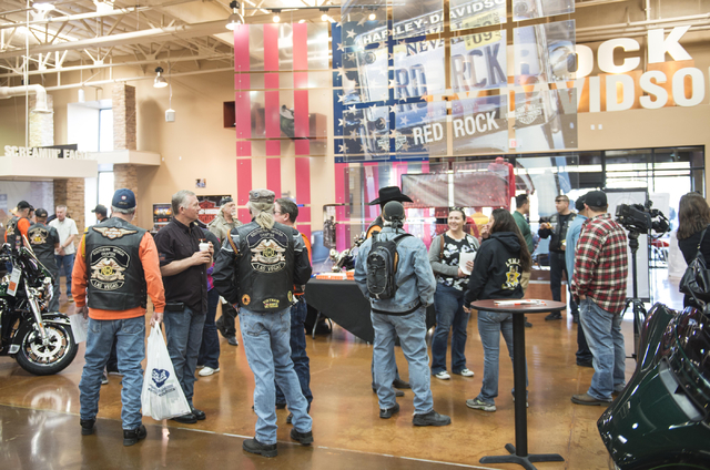 Attendees gather at Red Rock Harley-Davidson in Las Vegas during the annual Scoot and Shoot Poker Run on Saturday, March 21, 2015. The event, sponsored by the Las Vegas Metropolitan Police Departm ...