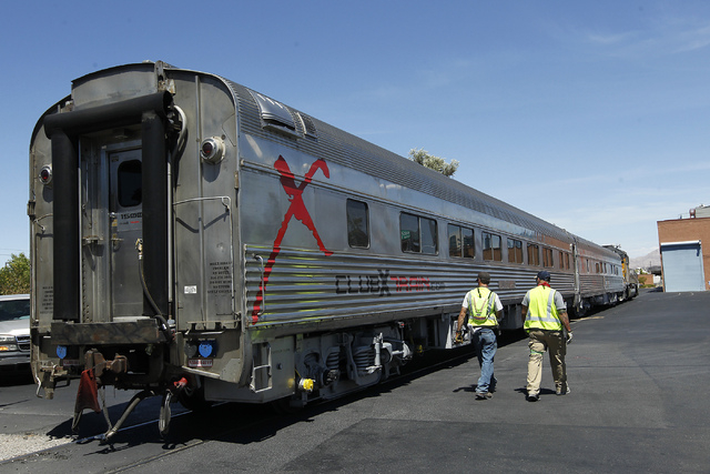 Union Pacific workers prepare a pair of Club X Train cars to be removed from the Las Vegas Review-Journal's parking lot near the intersection of Martin Luther King Boulevard and Bonanza Road in La ...