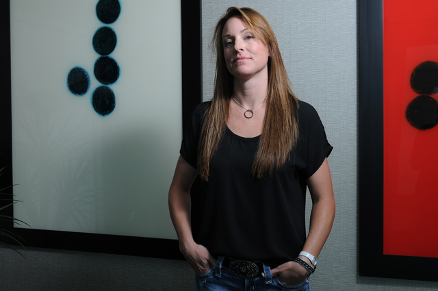 Former Utah resident Nicole McMillen poses for a portrait at Turnberry Towers in Las Vegas Tuesday, May 20, 2014. (Erik Verduzco/Las Vegas Review-Journal)