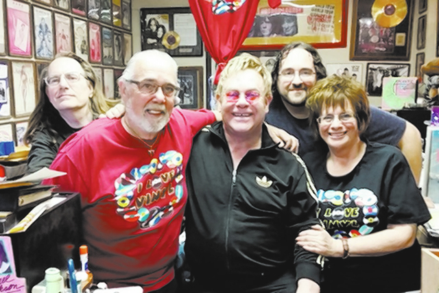Elton John made a special appearance at Wax Trax Records store in Las Vegas on Sunday, March 29, 2015. From left: Jerry Friend, Rich Rosen, Elton John, David Rosen and Sunny Rosen. The Rosen famil ...