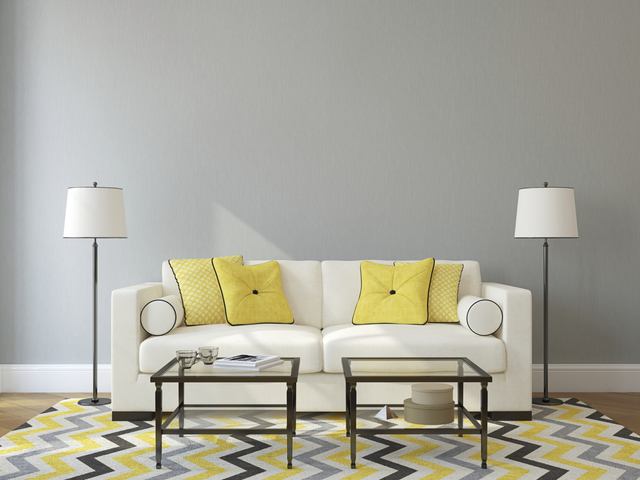 Thinkstock A colorful rug and pillows add visual interest to this living room.