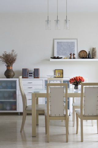 Thinkstock A modern cabinet stores the china and glassware in this trendy dining room.