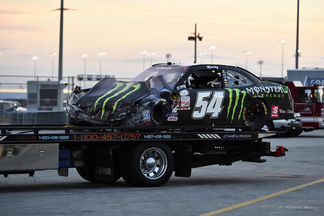 Feb 21, 2015; Daytona Beach, FL, USA; The car  of NASCAR Xfinity Series driver Kyle Busch (54) is towed to the  during the Alert Florida 300 at Daytona International Speedway. Mandatory Credit: Ja ...