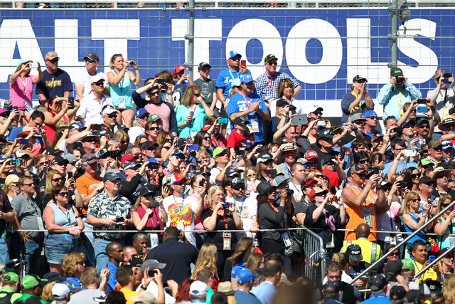 Fans cheer and take photos before the start of the NASCAR Sprint Cup Series Kobalt 400 race at the Las Vegas Motor Speedway on Sunday, March 8, 2015. (Chase Stevens/Las Vegas Review-Journal)