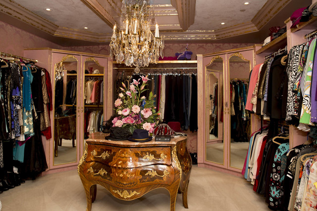 "Tonya Harvey/Real Estate Millions  If Elle Woods from the movie ""Legally Blonde"" grew up to become a prominent attorney and poker player, she would have this closet. Lined in pink damask fabri ..."