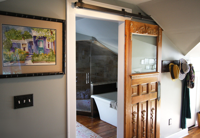 Courtesy Real Carriage Door Co. Real Carriage Door Co.'s Box Rail kit was used to hang this antique door that was repurposed as a sliding barn door.