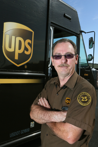 United Parcel Service driver Rod Little stands by a truck at the UPS Customer Center located at 740 N. Martin L. King Blvd. Monday, March 23, 2015, in Las Vegas. Little is a recipient of the UPS C ...