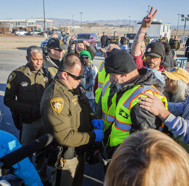 Las Vegas police arrest anti-drone warfare protester Father Louis Vatale, a priest from Oakland, Calif., at the south entrance to Creech Air Force Base at Indian Springs on Friday, March 6, 2015.  ...
