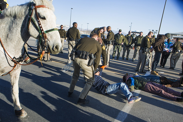Las Vegas police arrest anti-drone warfare protesters at the south entrance to Creech Air Force Base at Indian Springs on Friday, March 6, 2015.Thirty-fourwere arrested at the march. (Jeff Scheid/ ...