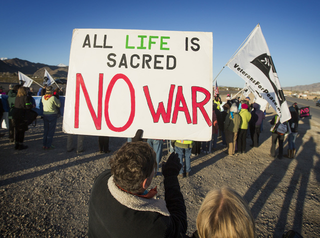 Anti-drone warfare protesters gather at the south entrance to Creech Air Force Base at Indian Springs on Friday, March 6, 2015. Nearly 150 protesters gathered with 34  being arrested at the march. ...