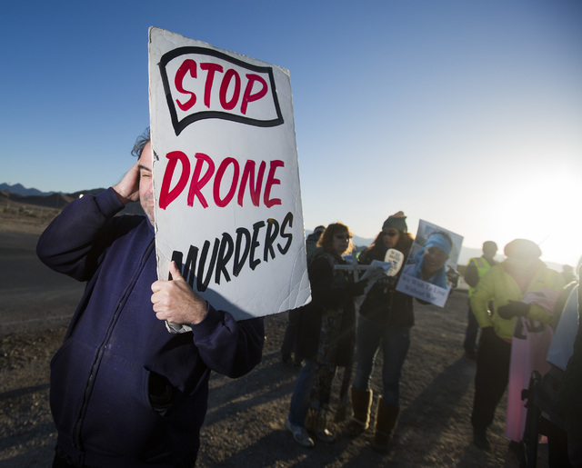 Anti-drone warfare protesters gather at the south entrance to Creech Air Force Base at Indian Springs on Friday, March 6, 2015. Nearly 150 protesters gathered with 34 being arrested during the mar ...