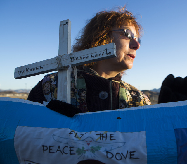 Janice Sevre-Duszynska protests at the south entrance to Creech Air Force Base at Indian Springs on Friday, March 6, 2015. Nearly 150 anti-drone warfare protesters gathered with a34 being arrested ...