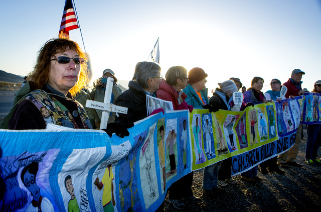 Janice Sevre-Duszynska,left, protests at the south entrance to Creech Air Force Base at Indian Springs on Friday, March 6, 2015. Nearly 150 anti-drone warfare protesters gathered with 33 protester ...