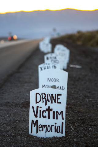 Anit-drone protest signs line U.S. 95 near the  south entrance to Creech Air Force Base at Indian Springs on Friday, March 6, 2015. Nearly 150 anti-drone warfare protesters gathered with 34 being  ...